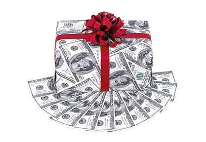 Money gift box with red ribbon and stack of dollars